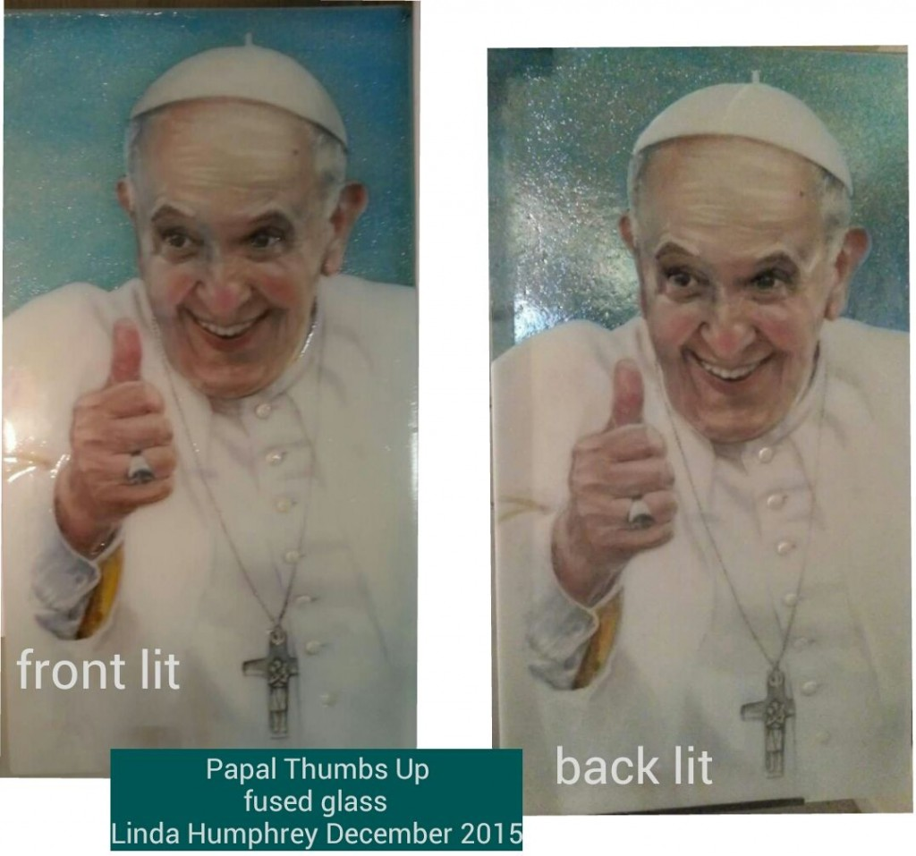 Papal Thumbs Up, fused glass drawing by Linda Humphrey, showing the difference between front lit and back lit.
