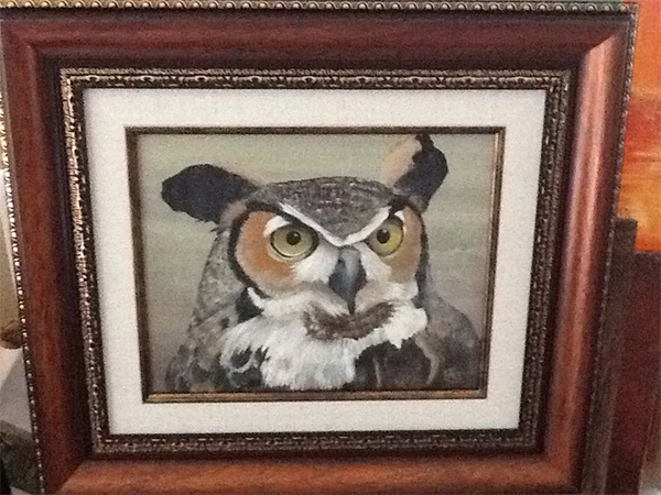 A painting by Iris Hardy of a great horned owl