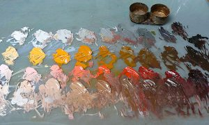 A color palette with yellow, reds and browns
