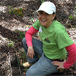 Photo of Amy Koch in the field measuring soil color layers