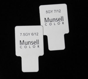 Backside of 2 Munsell color chips showing their notation