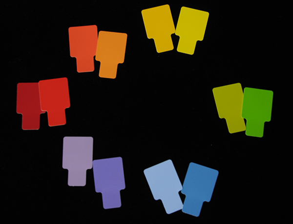 A rainbow of Munsell color chips on a black backdrop