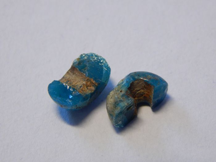 Ancient broken blue glass bead from the Viking Age.
