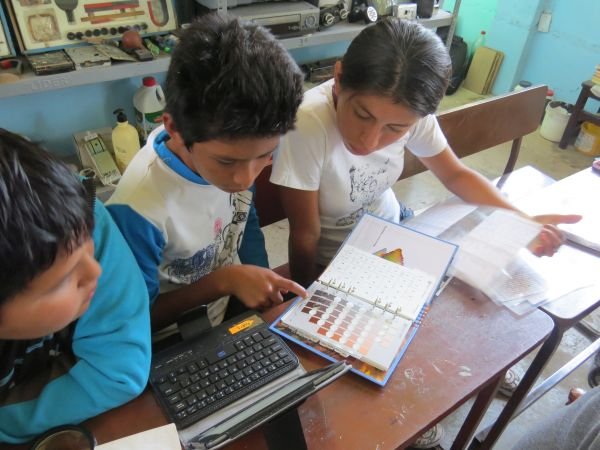 School students in Peru, learning to use the Munsell Color Book to record data from ceramic sherds curated in the museum at their school.