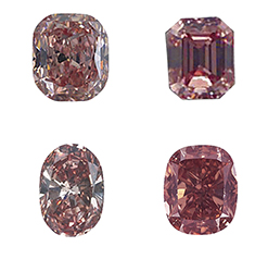 Four diamonds from the geological color chart shown in red hues