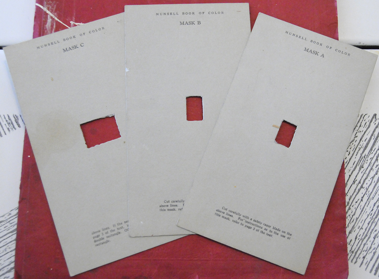 Three masks used for finding color notations when following directions for the use of the Munsell Book of Color Pocket Edition