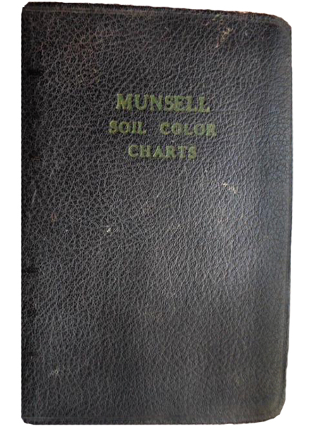 The 1954 1st edition Munsell Soil Book of Color in a dark paper cover