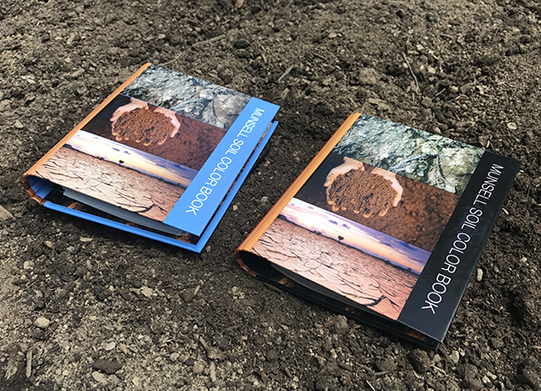The new Munsell Soil Color Book showing the brown and blue covers
