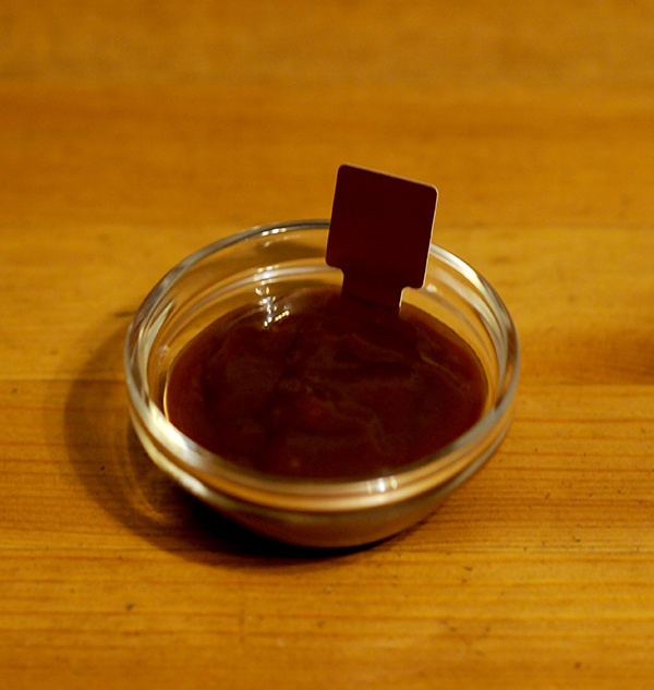 A glass jar filled with bbq sauce showing the Munsell color notation