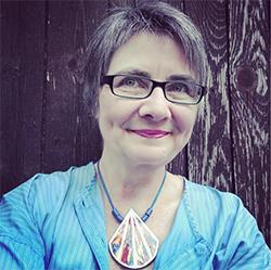 A photo of artist and writer Petra Van Cronenburg