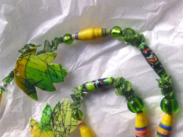 A necklace in yellow and green beads made from paper