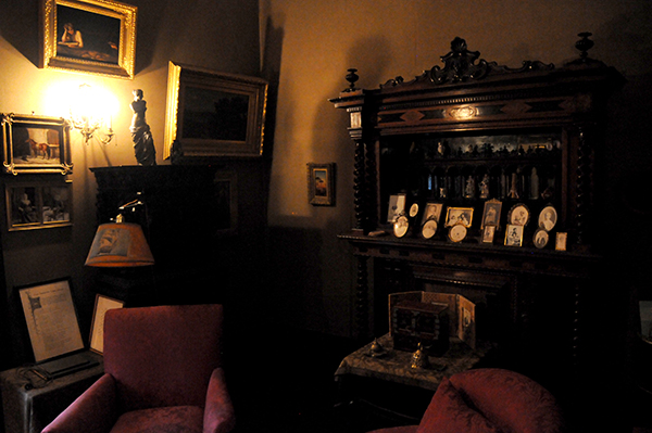 A view of the right corner of Sara Roosevelt's office at Hyde Park jam packed with furniture, paintings and treasures
