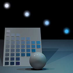 A ball with variations of light set in front of a Munsell color chart