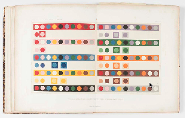 A color book open to a page with circles inside blocks of color