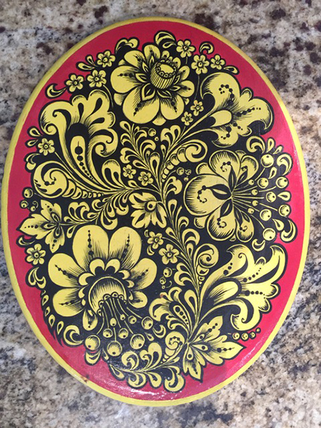 A traditional Russian folk art flower design acrylic paint on wood