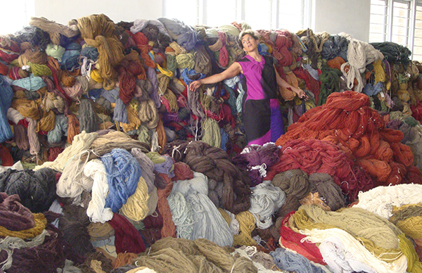 Artist Alicia D Keshishian drowns herself in piles of colorful yarn